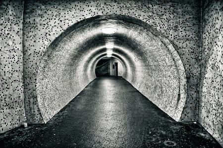 vanishing point: Abandoned old empty underground tunnel. Toned image