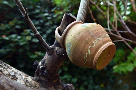 Hanging old, vintage clay jug, pot