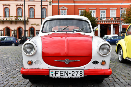 refurbished: CLUJ-NAPOCA, ROMANIA - OCTOBER 15, 2016: Eastern European Trabant and other vintage cars exhibited during the Retro Mobile Autumn Parade in the city of Cluj Napoca. Event organized by Retro Mobil Club Romania