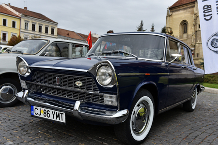 italian car: CLUJ-NAPOCA, ROMANIA - OCTOBER 15, 2016: Italian car FIAT and other vintage cars exhibited during the Retro Mobile Autumn Parade in the city of Cluj Napoca. Event organized by Retro Mobil Club Romania