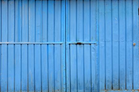 channeled: Grunge metallic garage door. Background pattern of a blue sheet metal Stock Photo