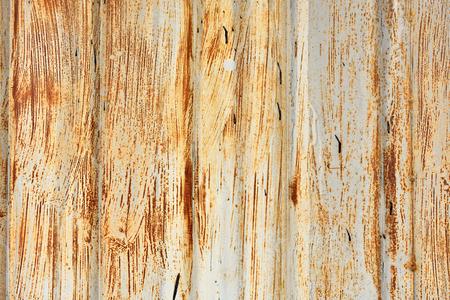 channeled: Grunge metallic garage door. Background pattern of a rusty sheet metal