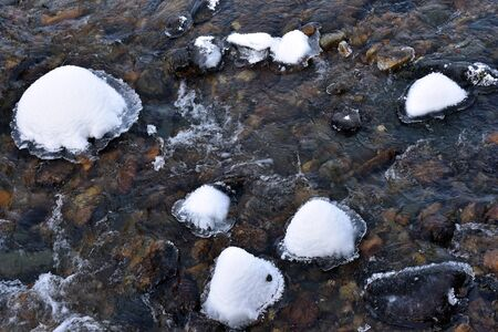 snowcovered: Small river with white snow-covered trees and rocks at winter Stock Photo