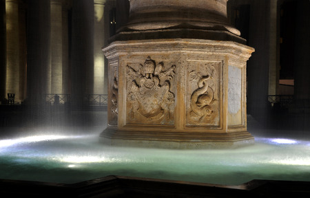maderno: VATICAN CITY - MARCH 13, 2016: The fountains in the Saint Peter square are made by Carlo Maderno and Lorenzo Bernini and are one of major tourist attractions Editorial