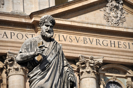 worshipped: VATICAN CITY - MARCH 13, 2016: The statue of Saint Peter in Piazza San Pietro in Vatican is worshipped and visited every year by crowd of pilgrims and tourists