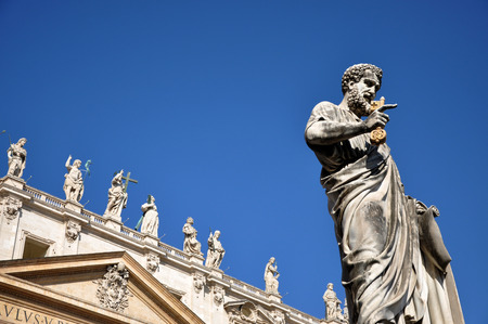 VATICAN CITY - MARCH 13, 2016: The statue of Saint Peter in Piazza San Pietro in Vatican is worshipped and visited every year by crowd of pilgrims and tourists