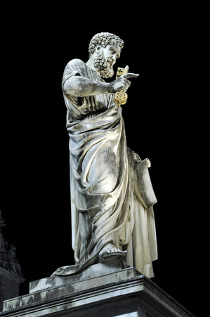 Marble statue of Saint Peter at night. Vatican city Stock Photo
