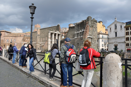 minerva: ROME, ITALY - MARCH 15, 2016: Tourists visiting the ancient Roman Imperial forum of Emperor Minerva in Rome, Italy