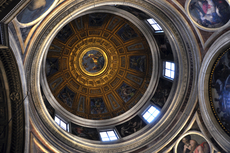 ROME, ITALY - MARCH 14, 2016: The ceiling of the dome of the Basilica of Santa Maria del Popolo was painted by famous medieval artists