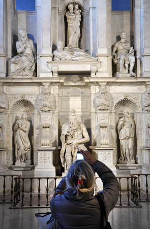 vincoli: ROME, ITALY - MARCH 16, 2016: Woman photographing the statue of Moses by Michelangelo with her smart phone in the San Pietro in Vincoli church Editorial