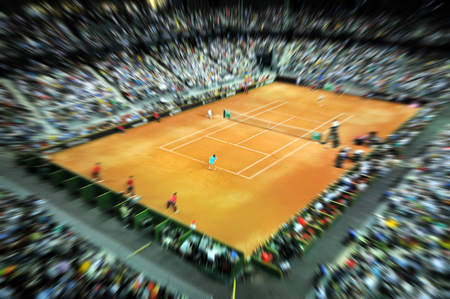 Blurred sports tennis arena with public in a dynamic motion. Zoom in effect