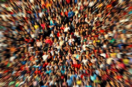 Blurred, defocused crowd of spectators on a stadium tribune at a baseball match