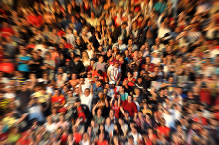 Blurred crowd of spectators on a stadium tribune at a sporting event Stock Photo