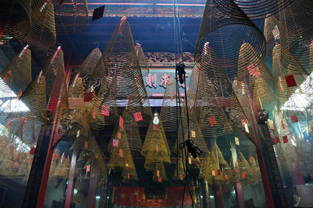 HO CHI MINH, VIETNAM - FEBRUARY 15, 2013: Burning spiral incense sticks hanging from the ceiling of Chua Ba Thien Hau pagoda, Saigon