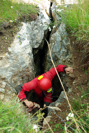 Caver descends in a cave. Spelunking is an extreme sport Foto de archivo