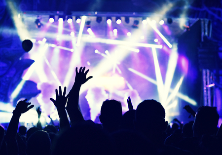 Silhouette of hands on a concert in front of bright stage lights Stok Fotoğraf