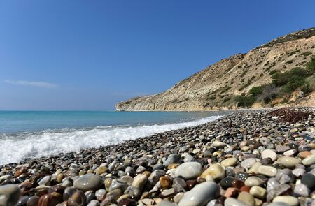 waves  pebble: Beach with pebble stones and beautiful tropical sea. Summer vacation concept. Pissouri bay, Cyprus island