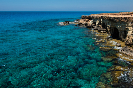 Sea caves (littoral caves) near Ayia Napa, Mediterranean sea coast, Cyprus. They are formed primarily by the wave action of the sea Stock Photo