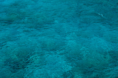 water wave: Natural background of transparent, emerald, turquoise sea water