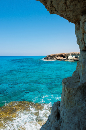 primarily: Sea caves (littoral caves) near Ayia Napa, Mediterranean sea coast, Cyprus. They are formed primarily by the wave action of the sea Stock Photo