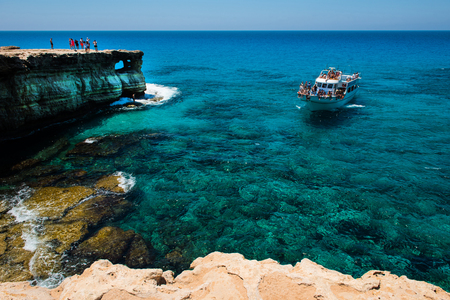 AYIA NAPA, CYPRUS, JUNE 15, 2017: Tourists visiting the sea caves of Ayia Napa. The littoral caves are one of the major tourist attractions of the island of Cyprus Editorial