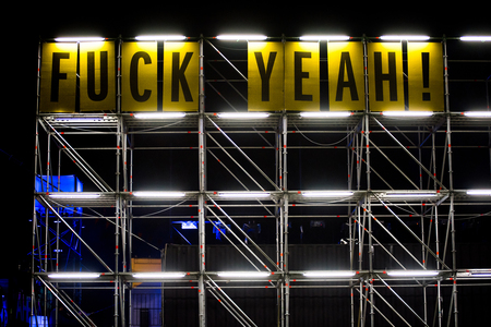 foda: BONTIDA, ROMANIA - JULY 16, 2017: On the main message board of the Electric Festival the messages were changed during the festival. Fuck yeah! words Editorial