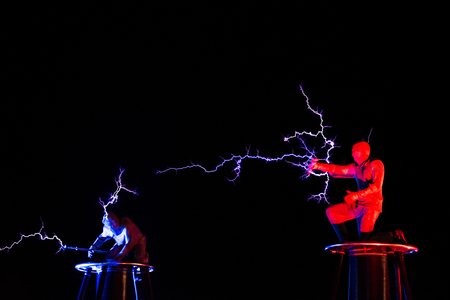 BONTIDA, ROMANIA - JULY  14, 2017: Lords of Lightning performing a high voltage electricity battle show at Electric Castle festival Редакционное