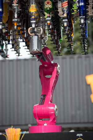 BONTIDA, ROMANIA - JULY 16, 2017: Makr Shakr Worlds first robotic bar system preparing drinks at Electric Castle festival. Cocktails served by robotic arms Editorial