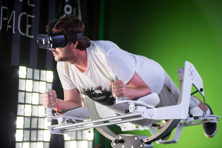 BONTIDA, ROMANIA - JULY 14, 2017: A guy using Samsung virtual reality headset. Man playing with a VR oculus googles at Electric Castle festival tech zone Editorial