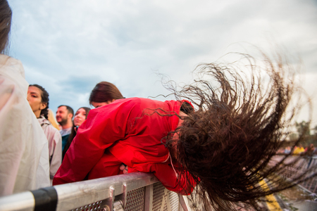 headbanging: BONTIDA, ROMANIA - JULY  15, 2017: Crowd of hardcore fans headbanging during an Architects concert at Electric Castle festival