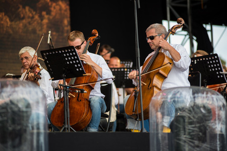 BONTIDA, ROMANIA - JULY 16, 2017: Hungarian Opera Philharmonia from Cluj performing live at Electric Castle Festival. Symphonic orchestra on the stage Editorial