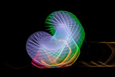 Suddigt jättehjul, ferris fotograferad med lång exponeringsteknik på natten. Rörelseoskärpa Stockfoto