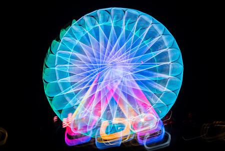 Blurred giant wheel, ferris photographed with long exposure technique at night. Motion blur