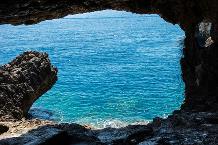 Sea view from a cave. Rocky coastline in Cyprus island Stock Photo
