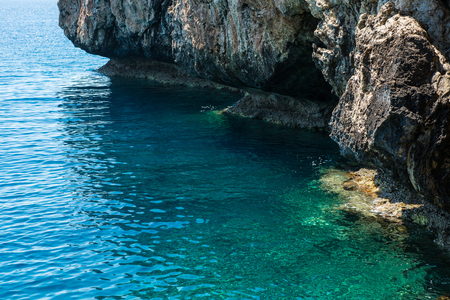 natural formation: Sea view from a cave. Rocky coastline in Cyprus island Stock Photo