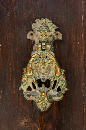 door handle: Bronze door knocker with lion head and cupids. Mdina, Valletta