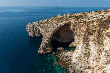Blue grotto cave in Malta. Natural limestone arch over a lagoon