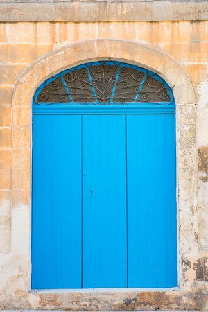 Traditional wooden, vintage painted blue door in Malta Stock Photo