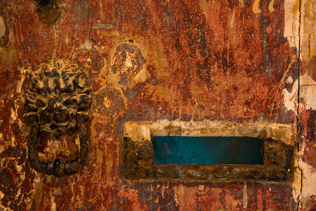 Vintage lion head door knocker and an old letterbox. Mdina, Malta