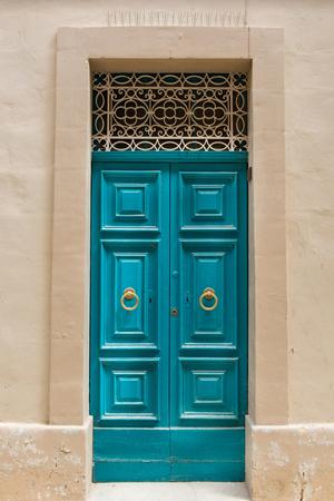 door handle: Traditional wooden, vintage painted turquoise door in Malta