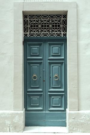door handle: Traditional wooden, vintage painted blue door in Malta Stock Photo