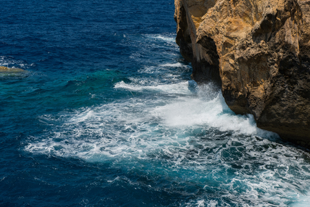 Rocky coastline and sea. Blue hole and the collapsed Azure window in Dwejra Bay, Gozo, Malta Stock Photo
