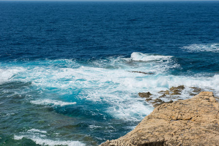 Rocky coastline and sea. Blue hole and the collapsed Azure window in Dwejra Bay, Gozo, Malta Stock Photo