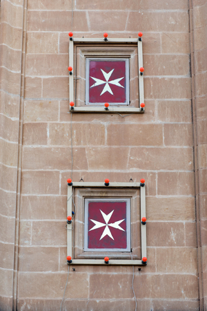 Maltese cross on a church. The cross symbol associated with the Order of St. John since 1567
