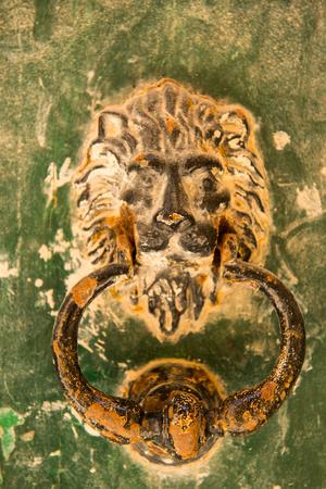 door handle: Old rusty lion head knocker in the medieval city of Mdina, Malta
