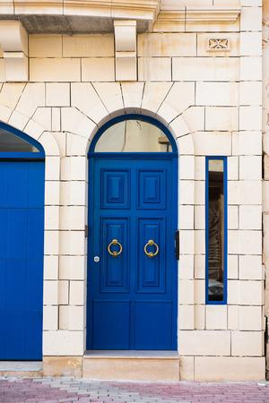 door handle: Traditional wooden, vintage painted blue door in Malta Editorial