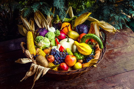 Basket of organic bio fruits and vegetables. Autumn harvest concept Stock Photo