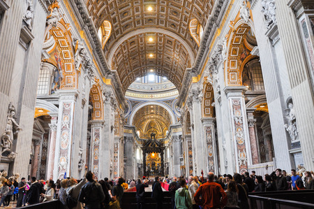 when: VATICAN - MARCH 16, 2016: The Saint Peter basilica in Vatican is the largest church in the world and is visited every day by crowd of tourists and religious pilgrims. The interior is of vast dimensions when compared with other churches Editorial