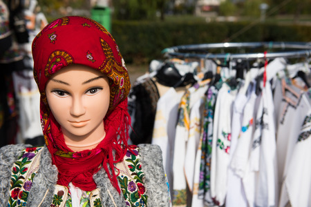 Romanian traditional costume on mannequin and hangers Stock Photo