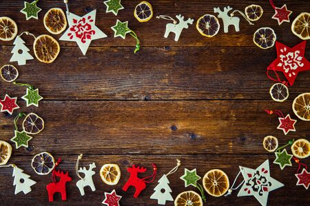 collection of christmas ornaments on a wooden christmas background space for text stock photo - Wooden Christmas Ornaments